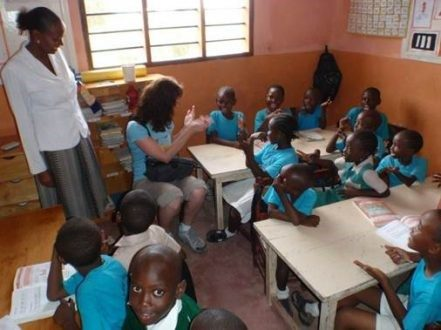 Our MD Kel learning to count in Swahili while visiting the school in 2012.