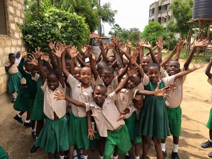 Miche Bora's students celebrate the news that their school has raised enough money to build six classrooms on the upper storey.